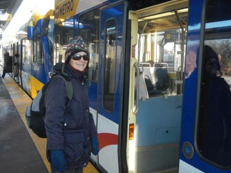 Trip leader Deb Alper boards the Blue Line
