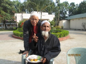 Louis with an Elder in Moulvibazar